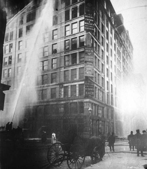 Water shooting up the side of the Triangle Shirtwaist Factory as firefighters try to put out the fire