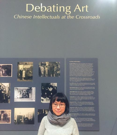 Yuhua Ding in front of her exhibition