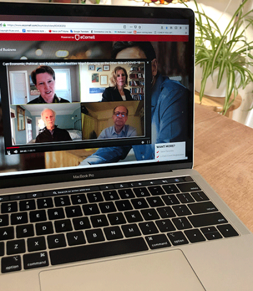 Computer screen showing four people