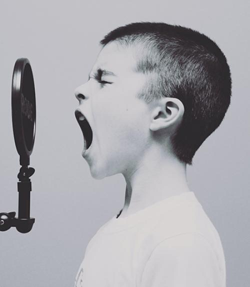Young person, talking into microphone