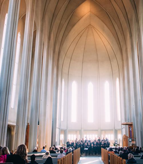 people congregated in a vaulted church sanctuary