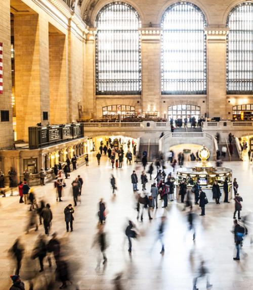 Crowds rushing through a station, photo byNicolai BerntsenonUnsplash
