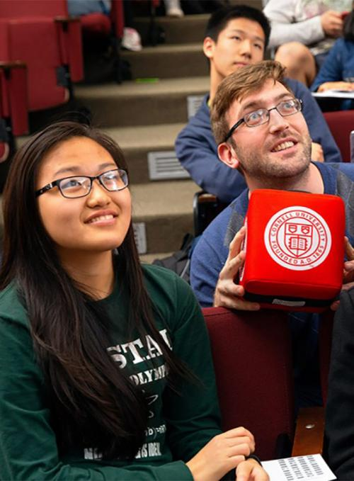Students with a catch box in an active learning class