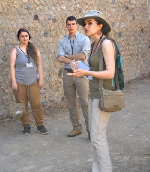Associate professor Caitlín Barrett takes the Casa della Regina Carolina Project group on a tour of Pompeii.