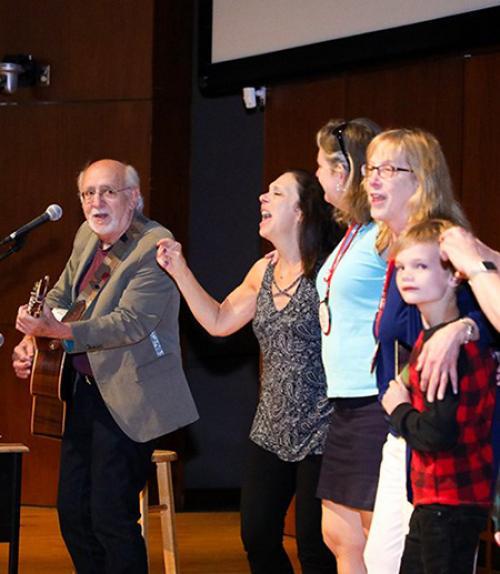 Peter Yarrow singing during Reunion 2019