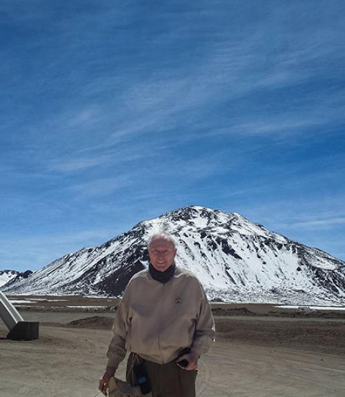 Fred Young standing in front of snow-covered mountain