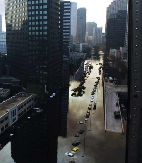 Tall buildings overlook a flooded street in New Orleans