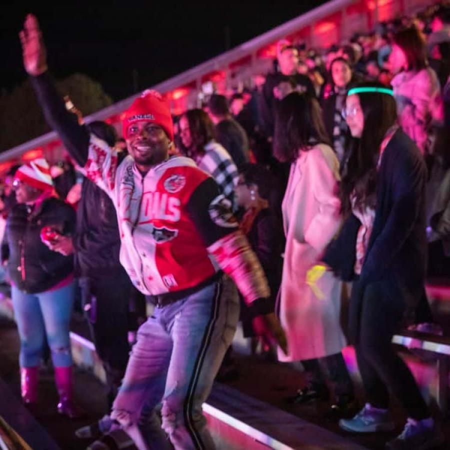 Students dancing at Schoelkopf Stadium