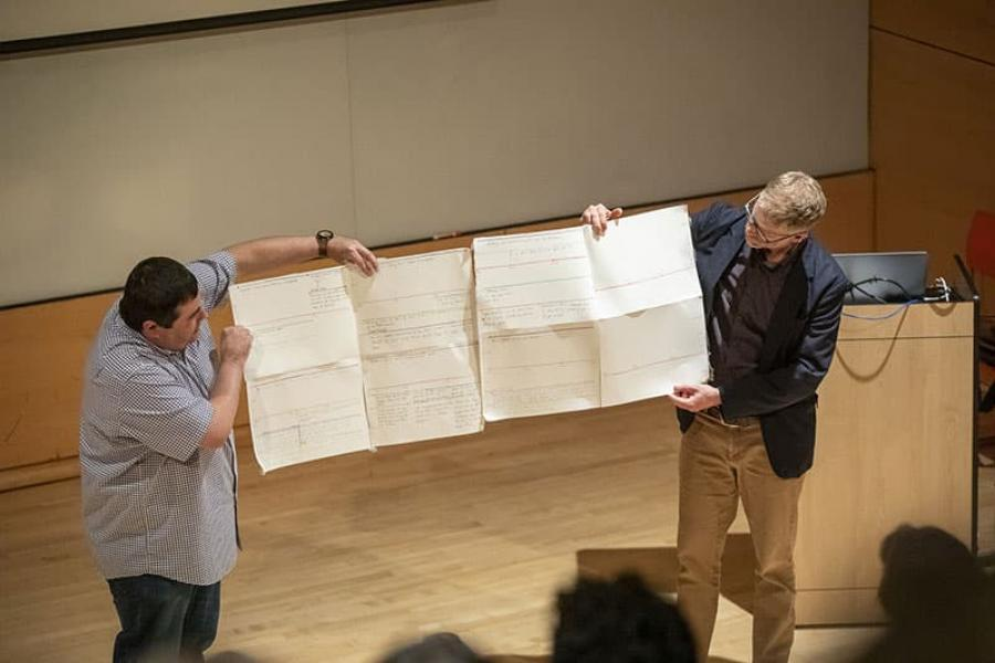 """Fillmmaker Jeffrey Palmer, left, and Austin Bunn, associate professor of performing and media arts, show off Palmer's early plans for """"Words from a Bear."""""""