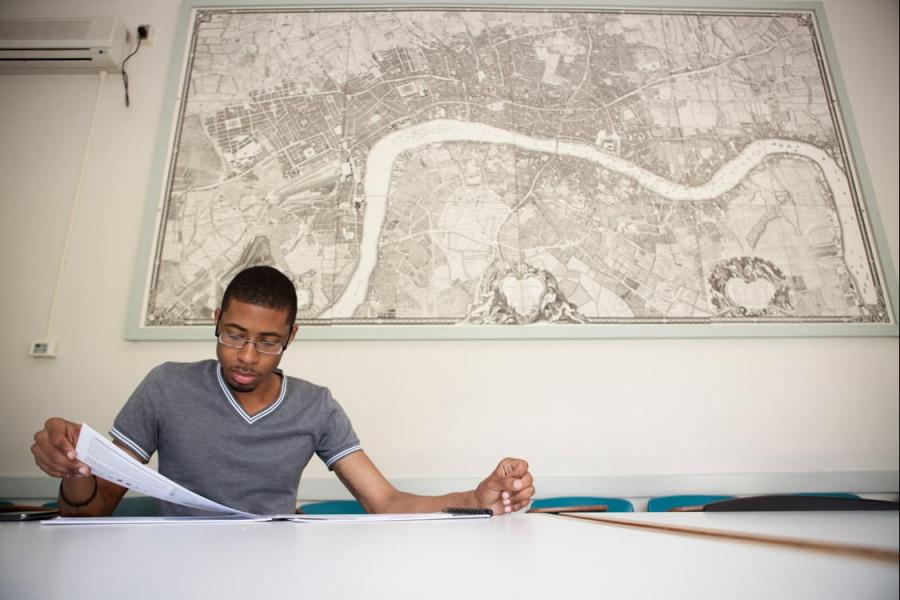 Student studying in front of a map