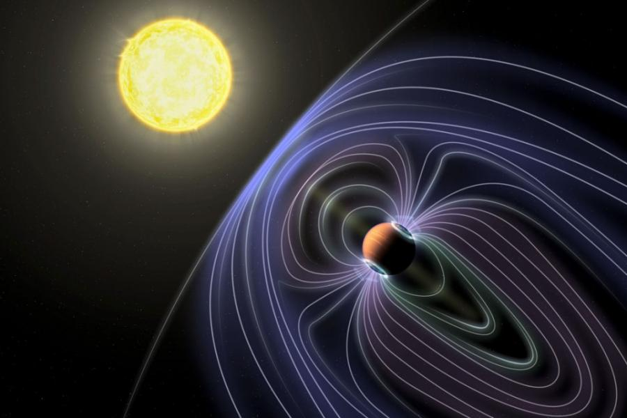 In this artistic rendering of the Tau Boötes b system, the lines representing the invisible magnetic field are shown protecting the hot Jupiter planet from solar wind.