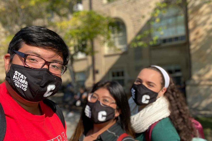 Students with masks on campus
