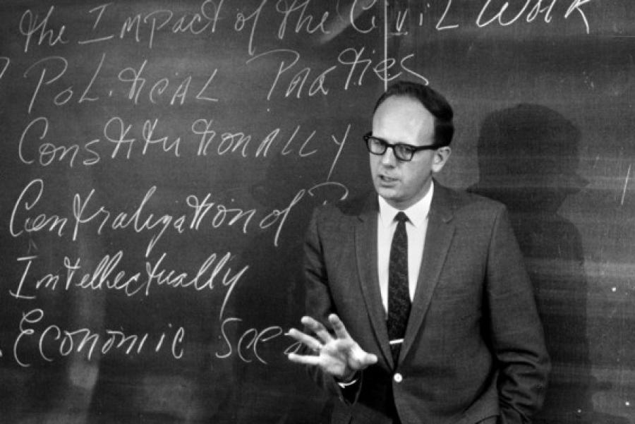 man at chalkboard