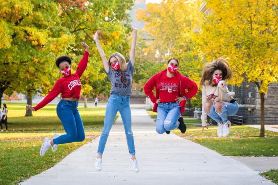 Four women jumping in celebration