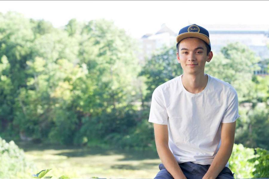 boy sitting outside