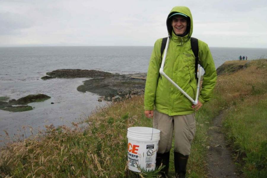 man in raincoat near ocean