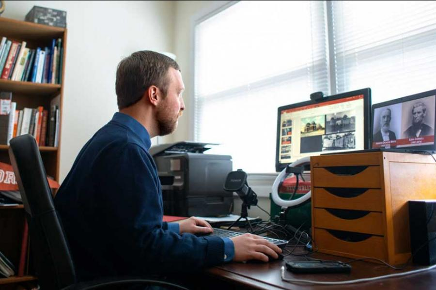 Person sitting at a desk with a computer