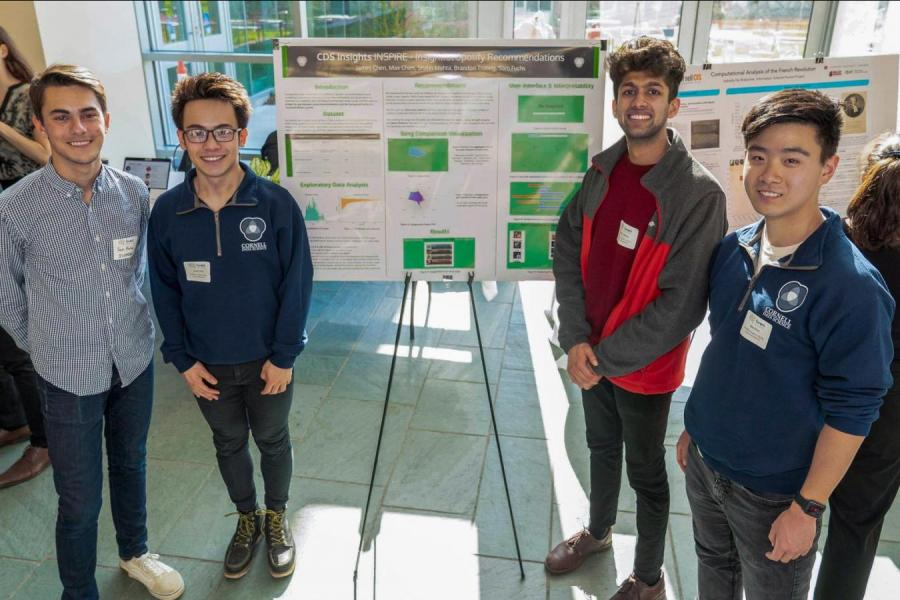 guys standing near research poster