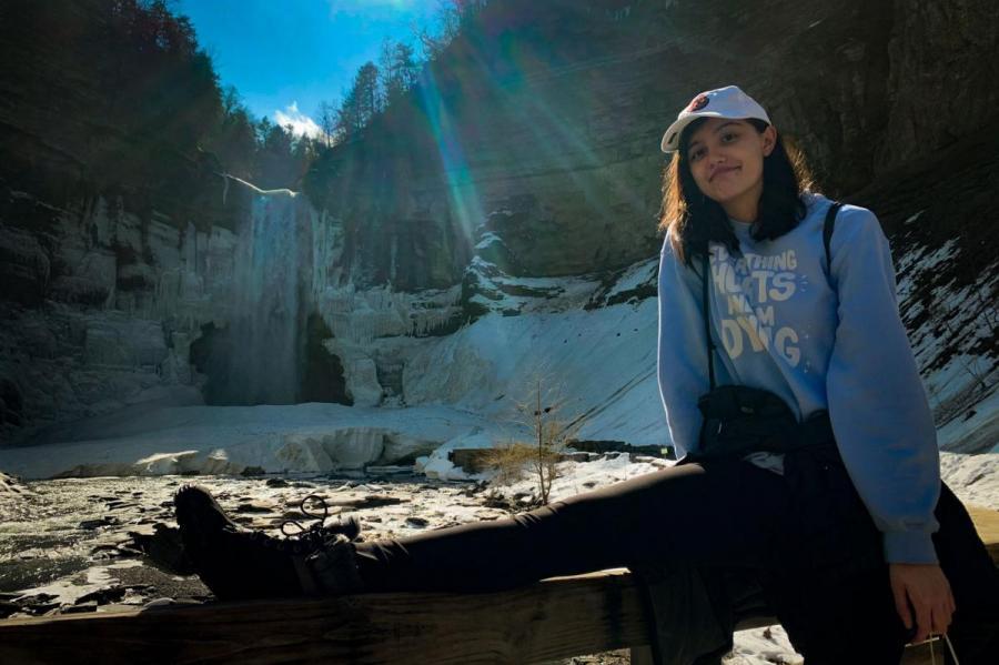 girl by waterfall