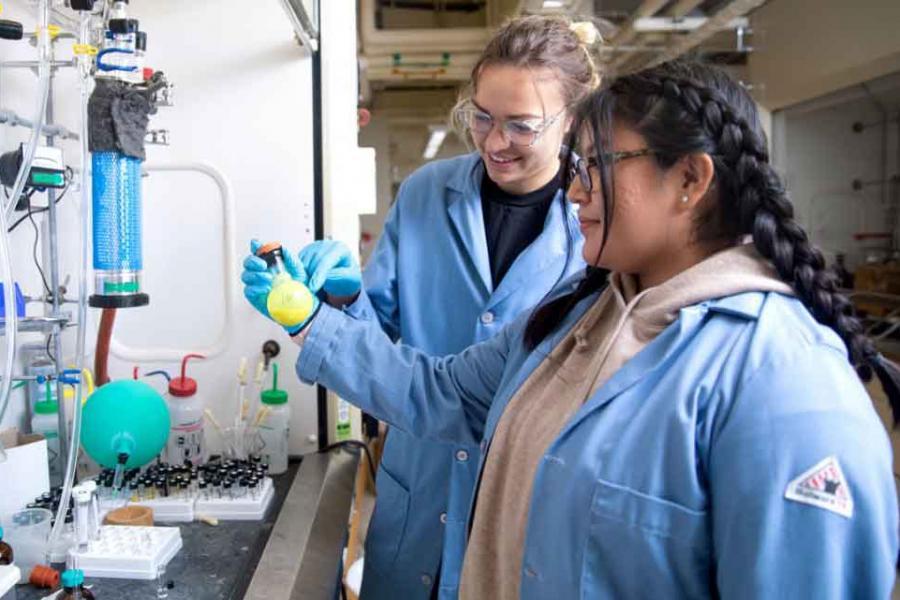 women in chemistry lab