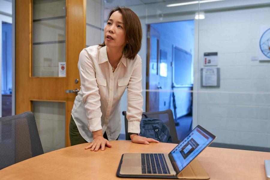Eun-Ah Kim leaning over computer