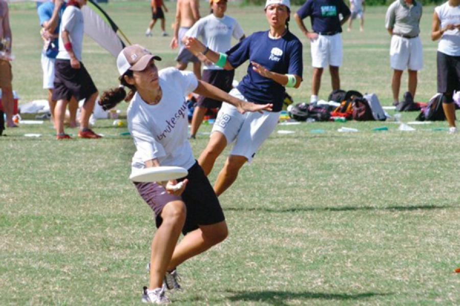 Person in shorts on a playing field