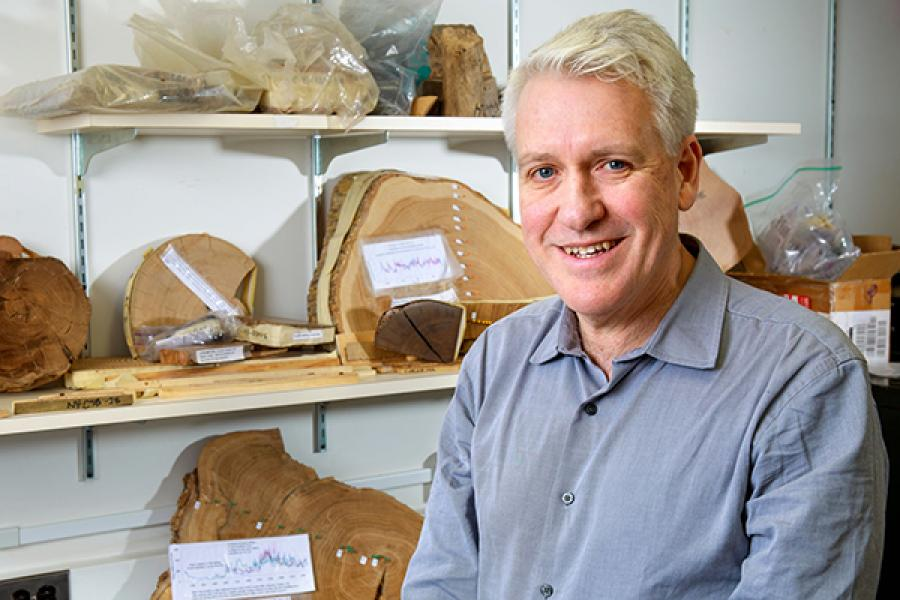 Person with shelves of artifacts