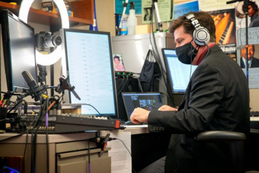 Person at a desk with recording equipment