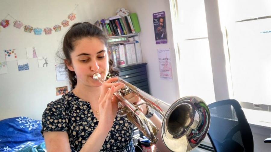 Person plays trombone