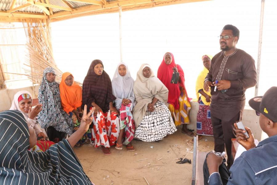 Elaigwu Ameh leading a workshop with internally displaced persons in Nigeria