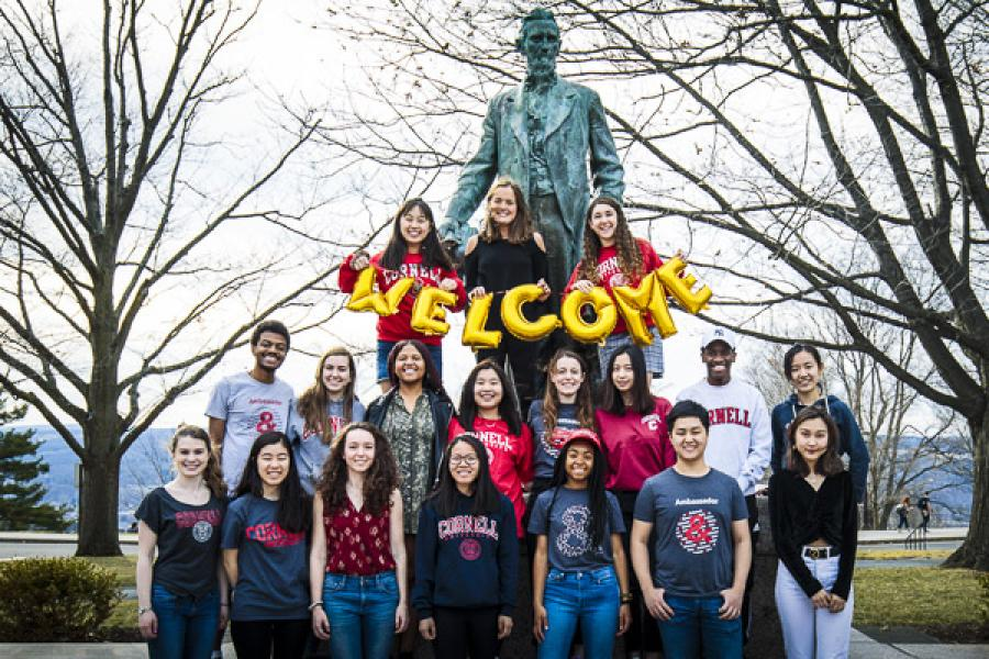 Arts & Sciences student ambassadors gathered around the Ezra Cornell statue to welcome new students
