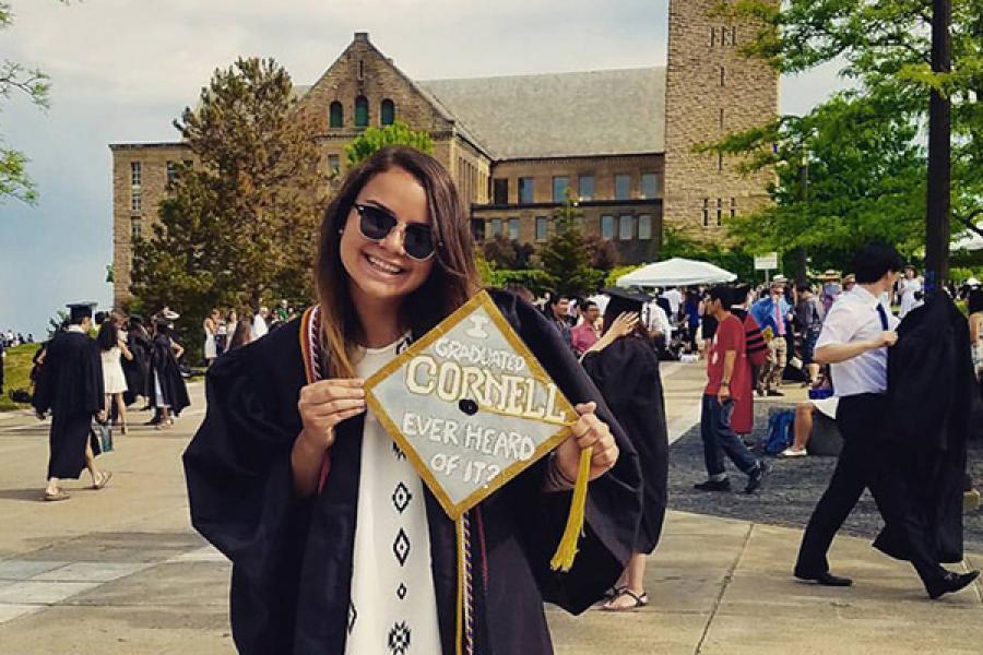 Person holding graduation cap