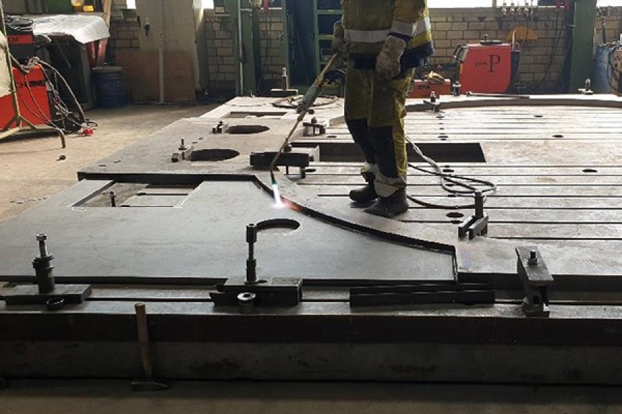 Person welding a large platform