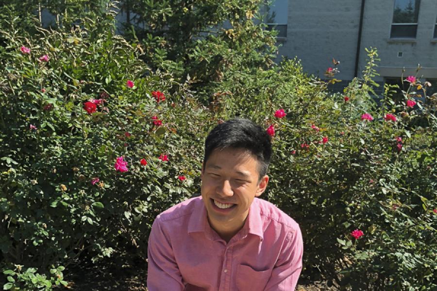 David Zhang in front of flowers