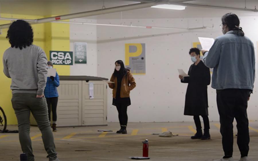 students sing in parking garage