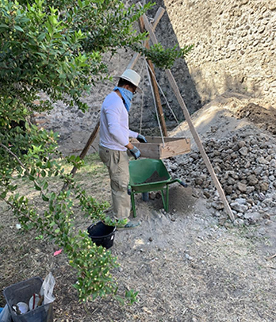 Joshua Johnson working on an archaeological dig site