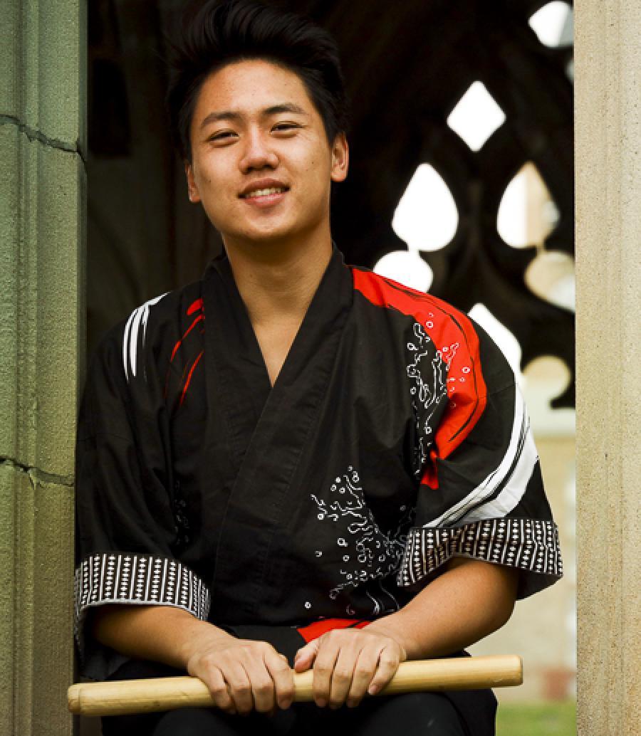 Kalen Chang with taiko drum sticks