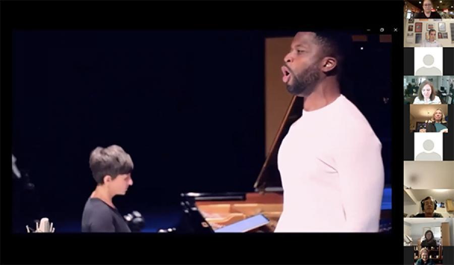 man singing and woman playing piano