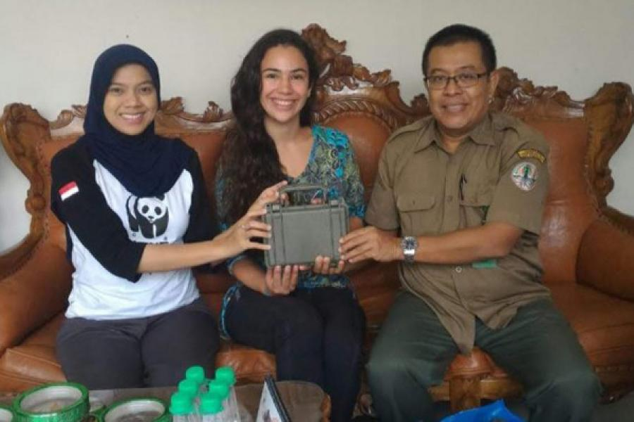 Montana Stone '19, center, is pictured with rhinoceros field researcher Dr. Kurnia Khairani, left, and U Mamat Rahmat, a researcher from Bogor Agricultural University. They are holding a Swift audio recorder, created by the Lab of Ornithology's Bioacoustics Research Program.