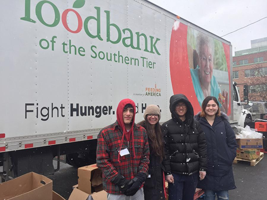 Students outside a food bank truck