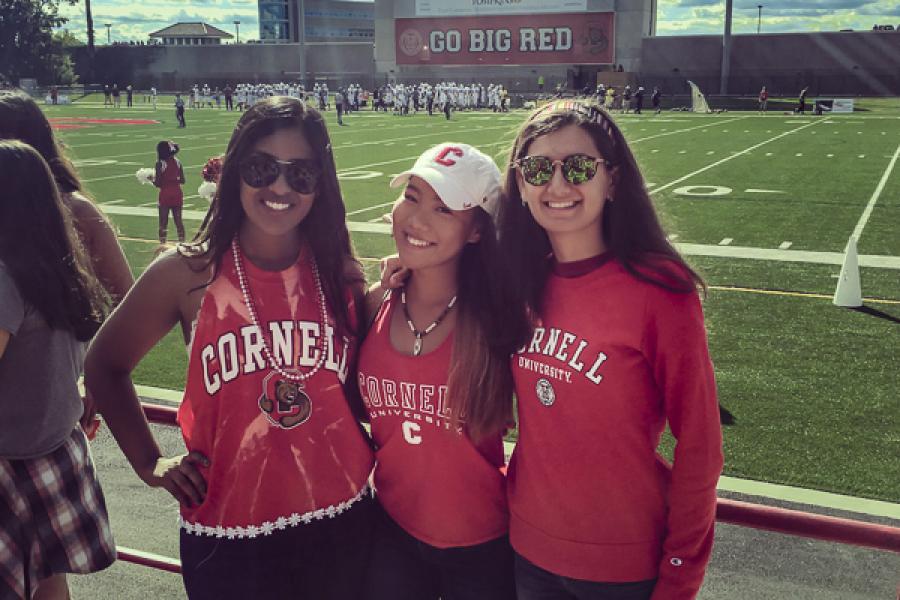 shiana kuriakose and friends in Cornell shirts at the football stadium