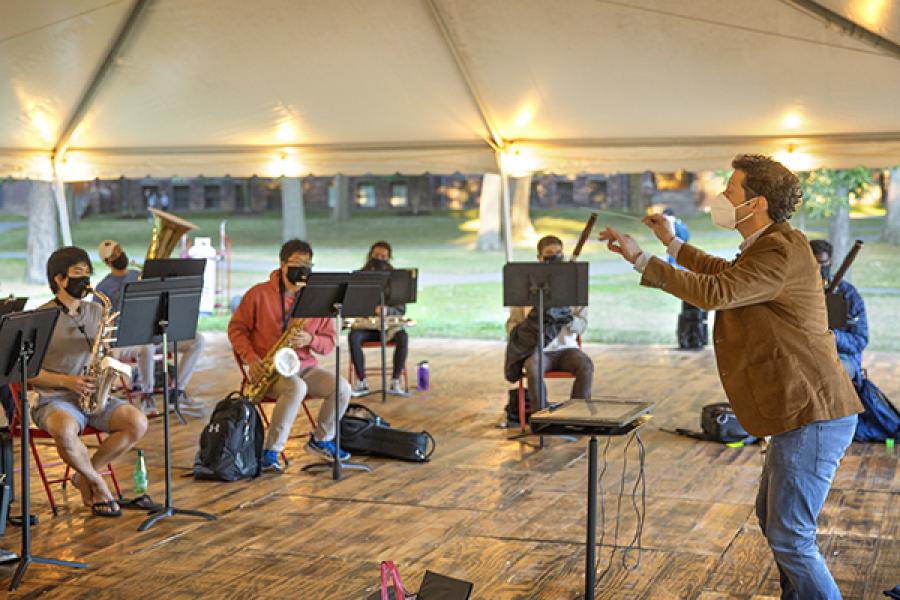 Musicians playing in a tent