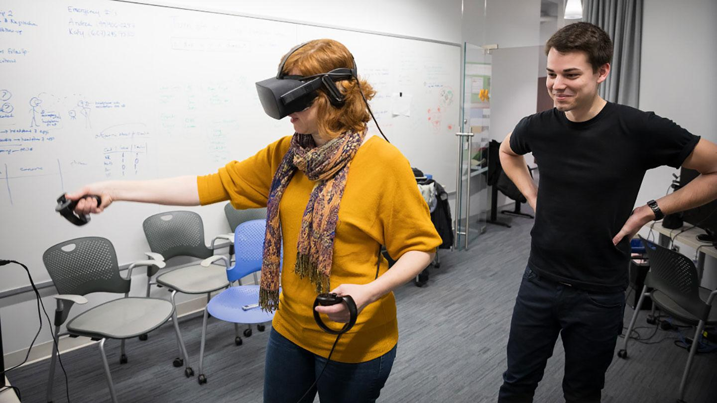 Researchers using VR goggles to study teaching methods